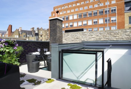 Rooflights enhance extensive roof terrace in luxurious London mews house