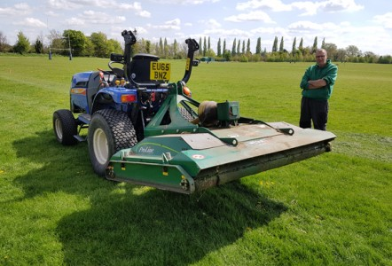 Rotary mower cutting it at Cambridge